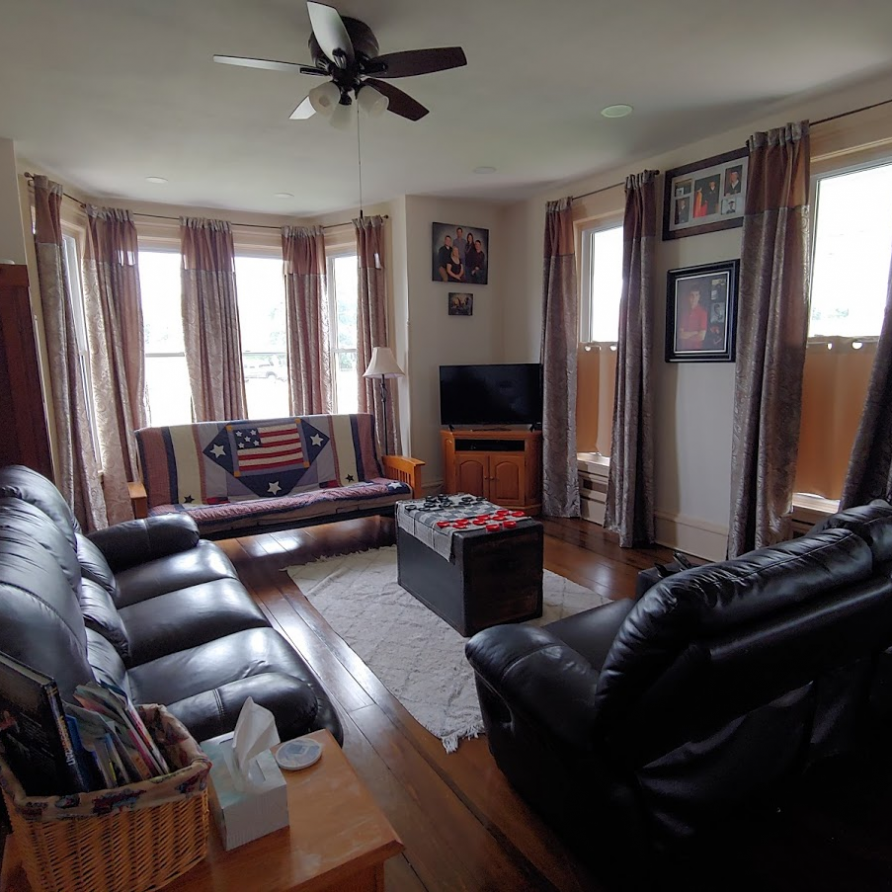 This is the shared living area with plenty of seating for watching Tv
